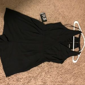 Size 8 Express Romper with pockets. Black. NWT.